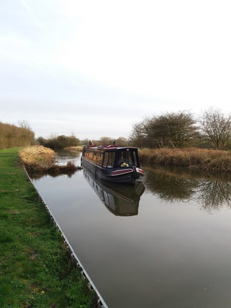 NB Firecrest cruising on Leicester Line Grand Union canal